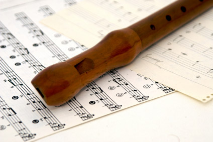 recorder on sheet music