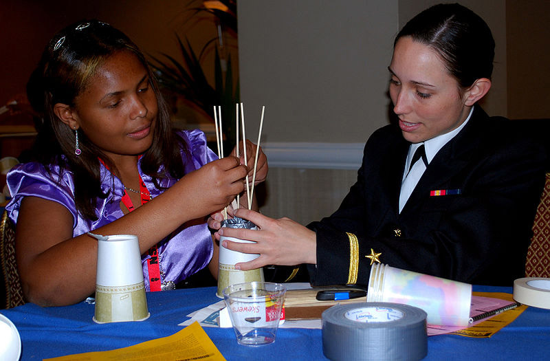 800px-US_Navy_090326-N-9268E-003_Ensign_Natalie_Alford_helps_a_student_during_a_science_competition_at_the_National_Society_of_Black_Engineers_conference_in_Las_Vegas