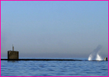 Submarine With Water and Air Gushing from Ballast Tanks
