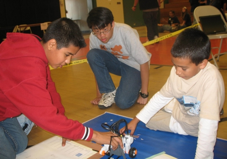 Young Students Work with Robotics