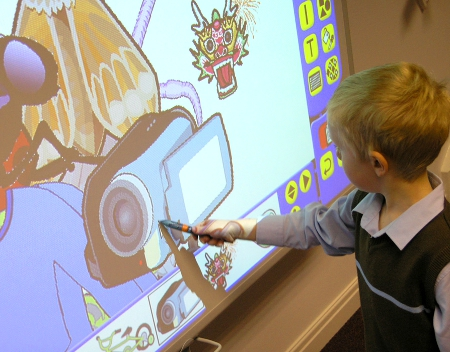 A Student Uses an Interactive Whiteboard