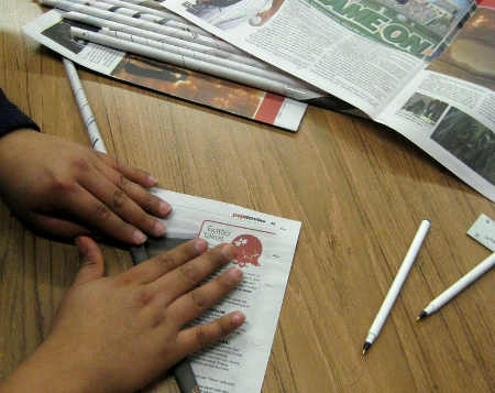 Rolling Newspaper for Building a Paper Tower