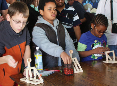 Kids Aim at a Target Using Catapults