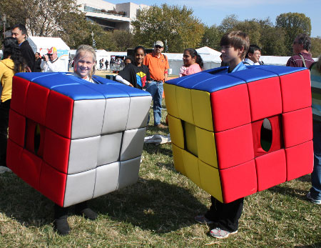Kids Dress as Rubix Cubes Promote a Contest