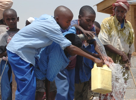 Children in Africa Pour Fresh, Clean Water into Jugs