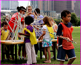 kids building straw structure in Austin
