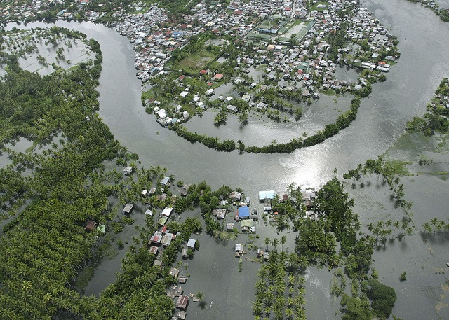 This aerial view shows a flooded area of the city of Cotabato as the Philippine Air Force continues its search and rescue operation on July 5, 2008 some two weeks after Typhoon Fengshen hit the country.  Typhoon Fengshen battered the archipelago on June 21 causing floods and damage to property amounting to over 50 million USD and killed more than 500 people, with another estimated 800 people lost when a ferry sunk off the central Philippines during the storm.    AFP PHOTO/Mark NAVALES