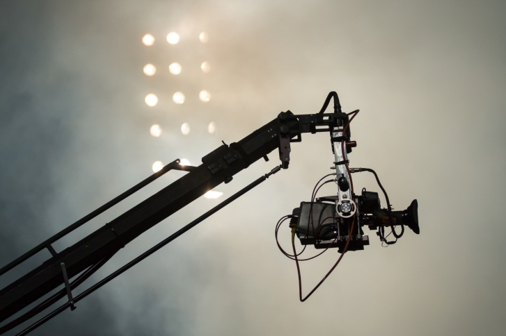 Camera on crane at football game
