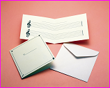 card and envelope with musical notes