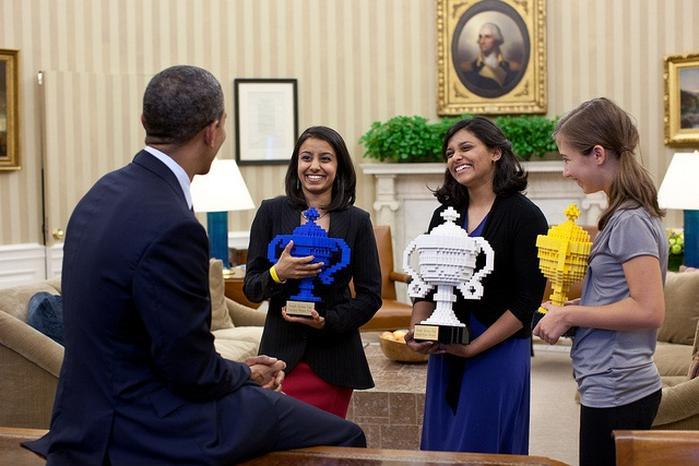 President Barack Obama congratulates Google Science Fair winners, from left, Naomi Shah, Shree Bose, and Lauren Hodge in the Oval Office, Oct. 3, 2011. (Official White House Photo by Pete Souza) This official White House photograph is being made available only for publication by news organizations and/or for personal use printing by the subject(s) of the photograph. The photograph may not be manipulated in any way and may not be used in commercial or political materials, advertisements, emails, products, promotions that in any way suggests approval or endorsement of the President, the First Family, or the White House.Ê