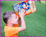 boy viewing eclipse using cereal box pinhole projector