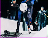 Mike Rogals pushes bobsled